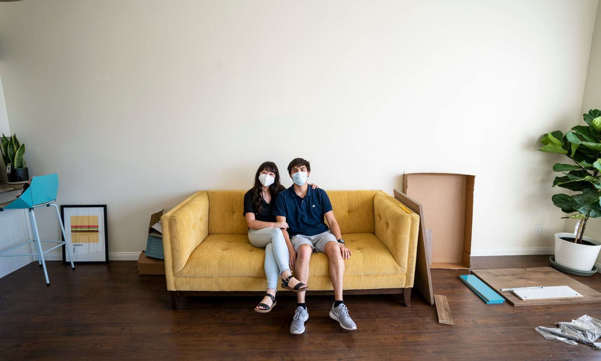 Young couples first home together. Buying real estate during corona virus covid 19 pandemic