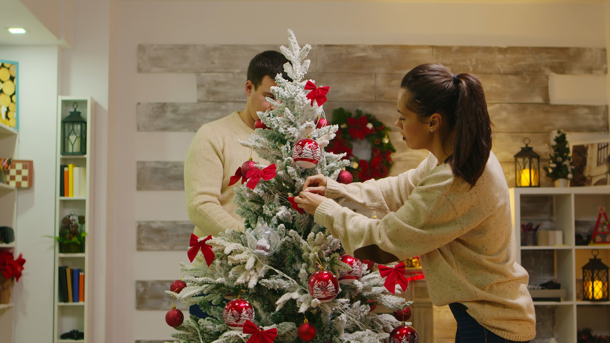 Young couple in love assembled christmas tree